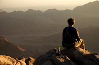 Joel watching sunrise from Mt. Sinai