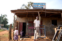 Kirabo Jonah in front of the vocational skills center he founded in Kalule