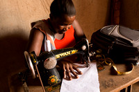 a pupil at Jonah's vocational school practices her sewing